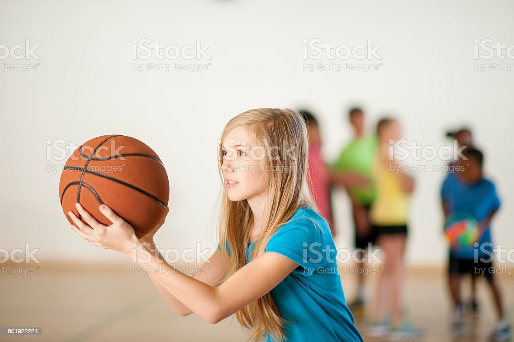Shooting Hoops at the Gym stock photo