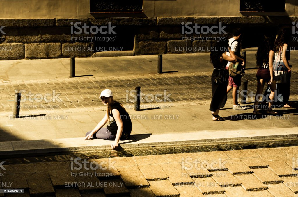 MADRID, SPAIN - AUGUST 4, 2014: Shooting of Madrid tourist's eyes. City architecture. Unknown people on streets of Madrid. stock photo