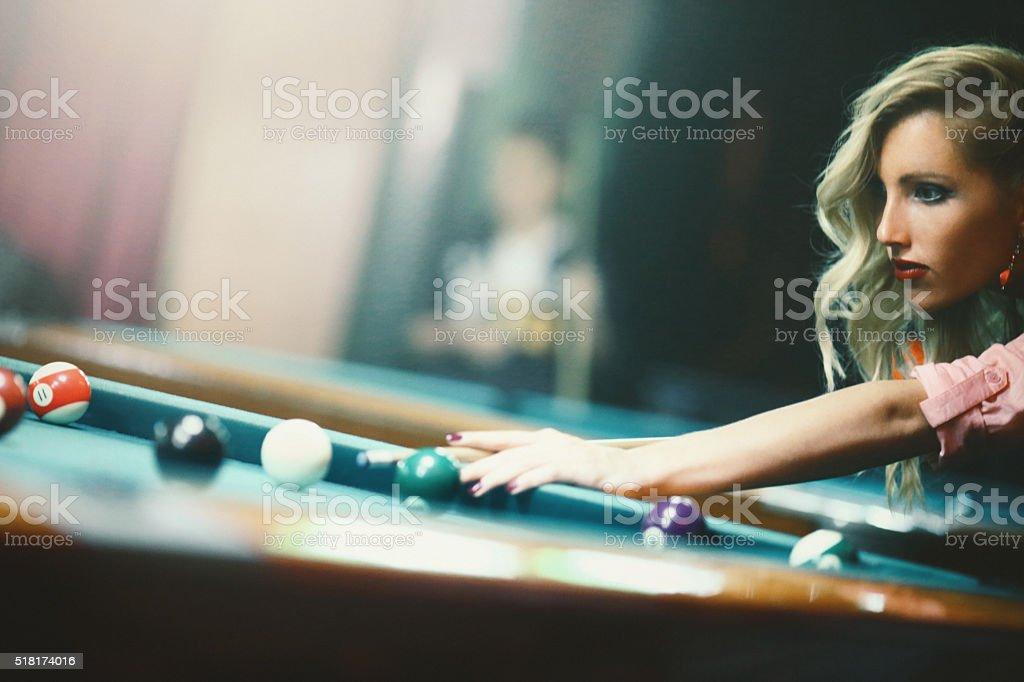 Shooting pool on weekend night. stock photo