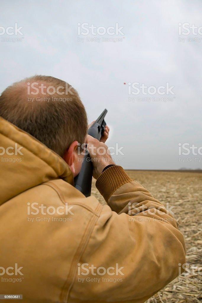 shooting skeet on overcast day stock photo