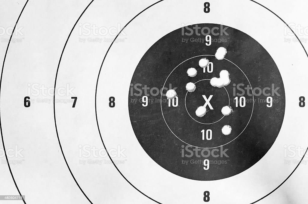 shooting target and bullseye with bullet holes stock photo