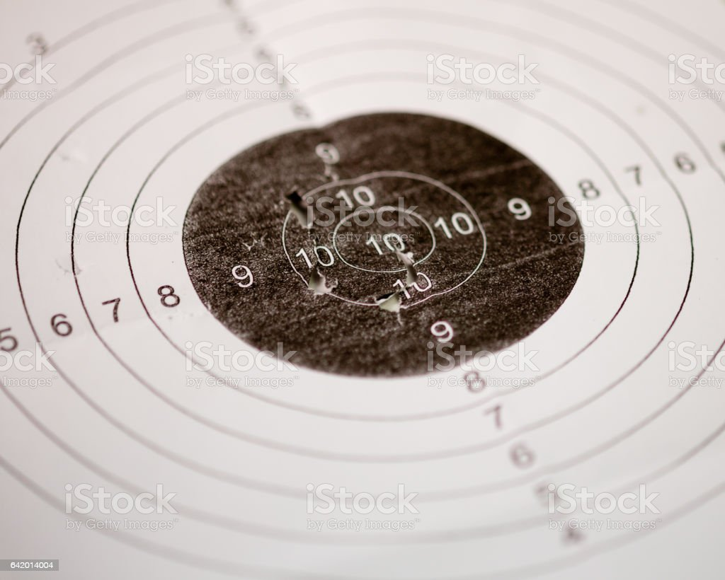 Shooting target with bullet holes stock photo