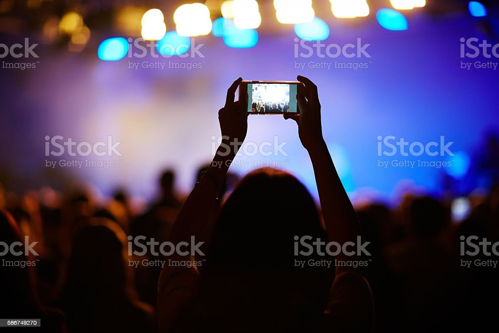 Shooting the concert stock photo