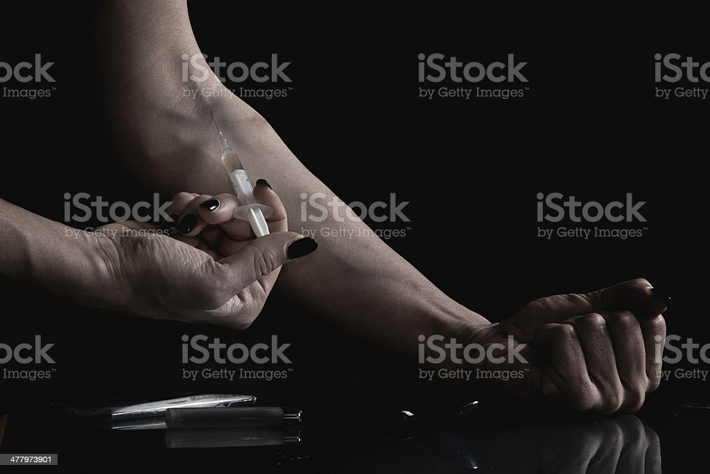 Shooting up narcotic stock photo