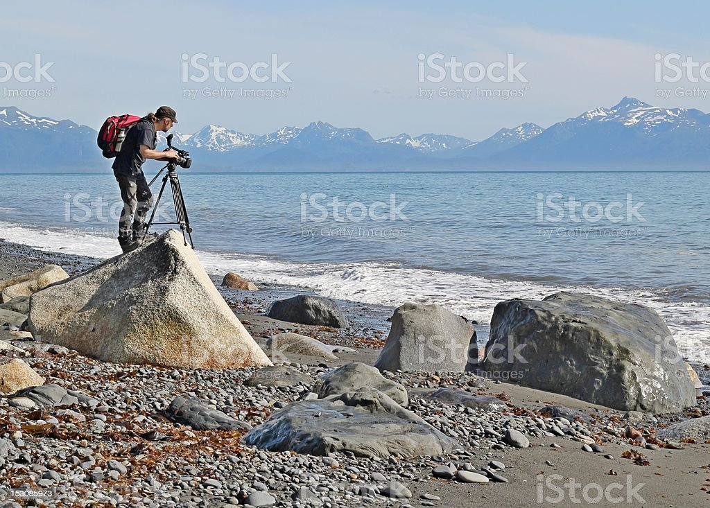 Shooting video at the beach royalty-free stock photo