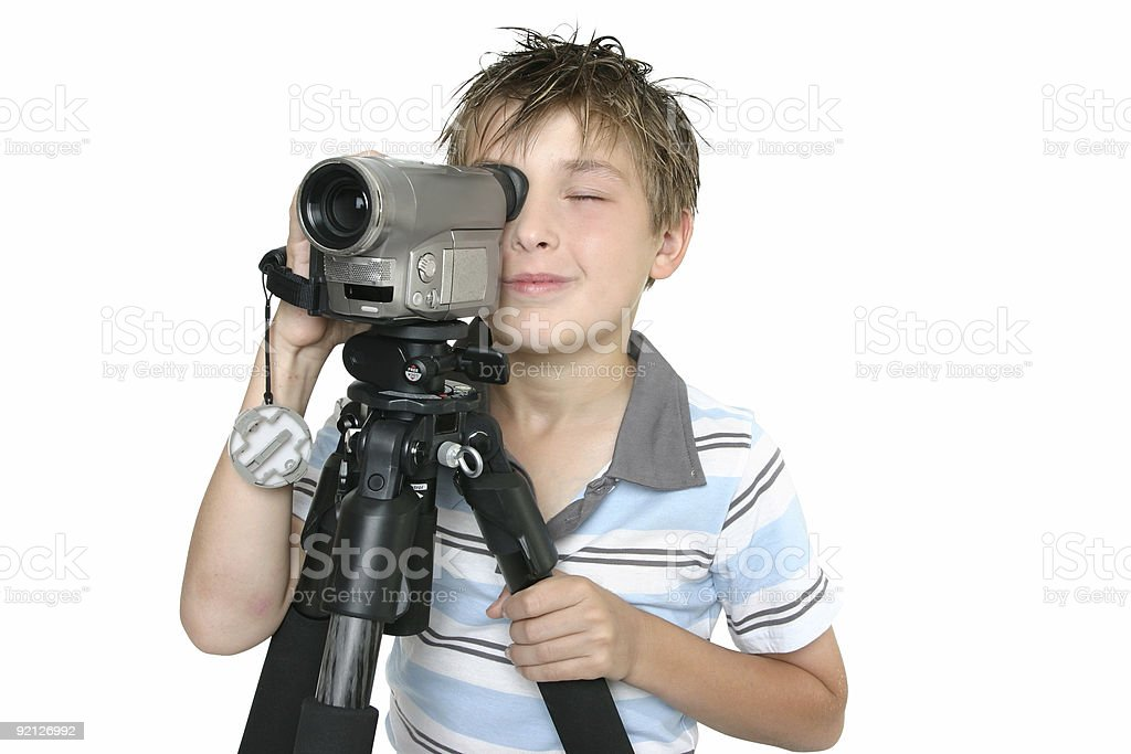 Shooting video with tripod royalty-free stock photo