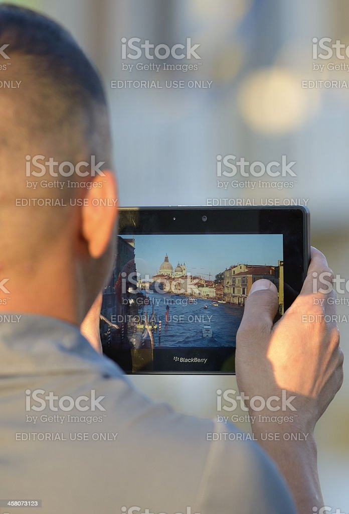Shooting with the tablet stock photo