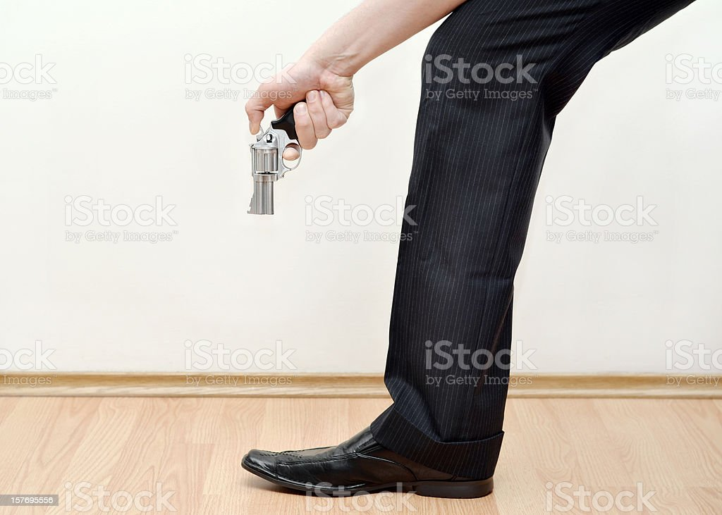Shooting Yourself in the Foot royalty-free stock photo