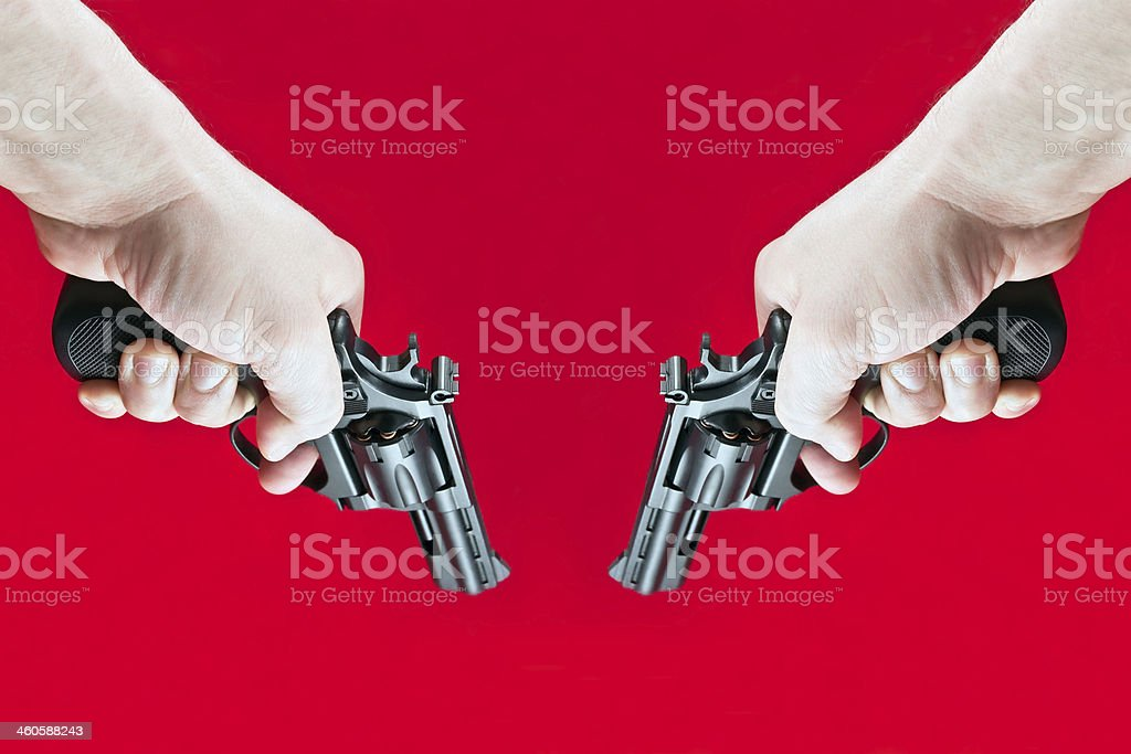 shoots out two revolvers stock photo
