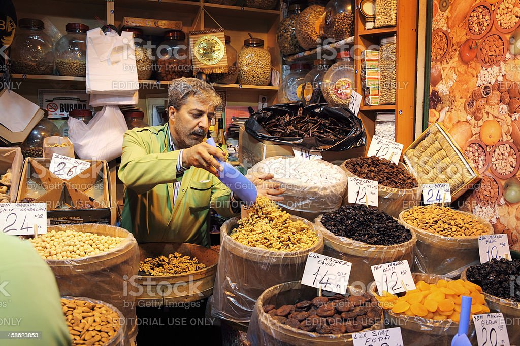 Shop assistant arranging his commodities royalty-free stock photo