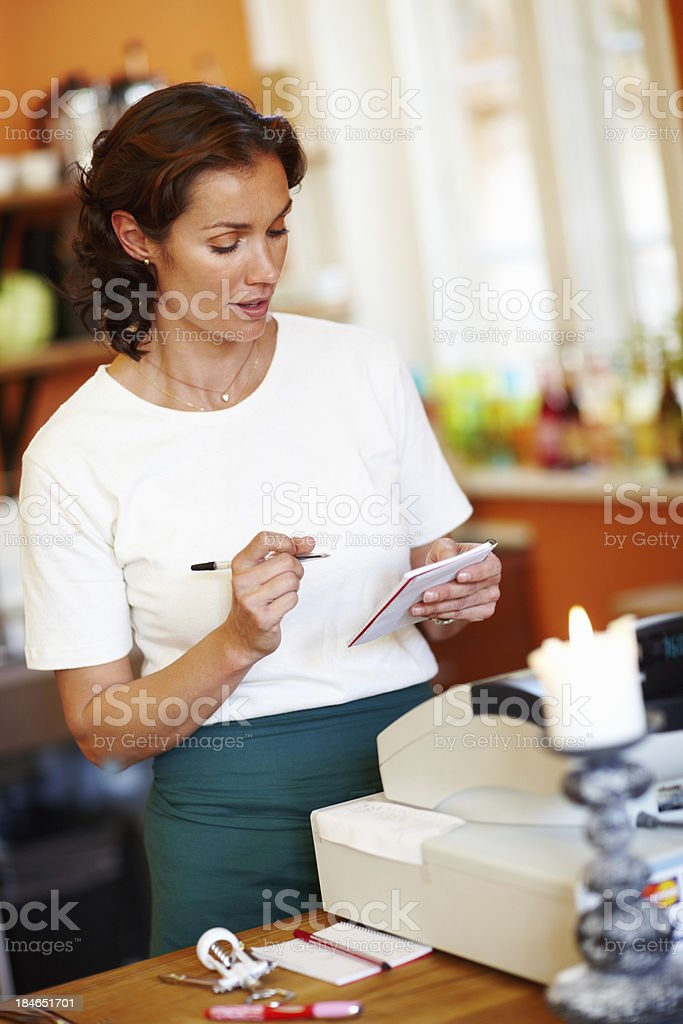Shop assistant at work royalty-free stock photo
