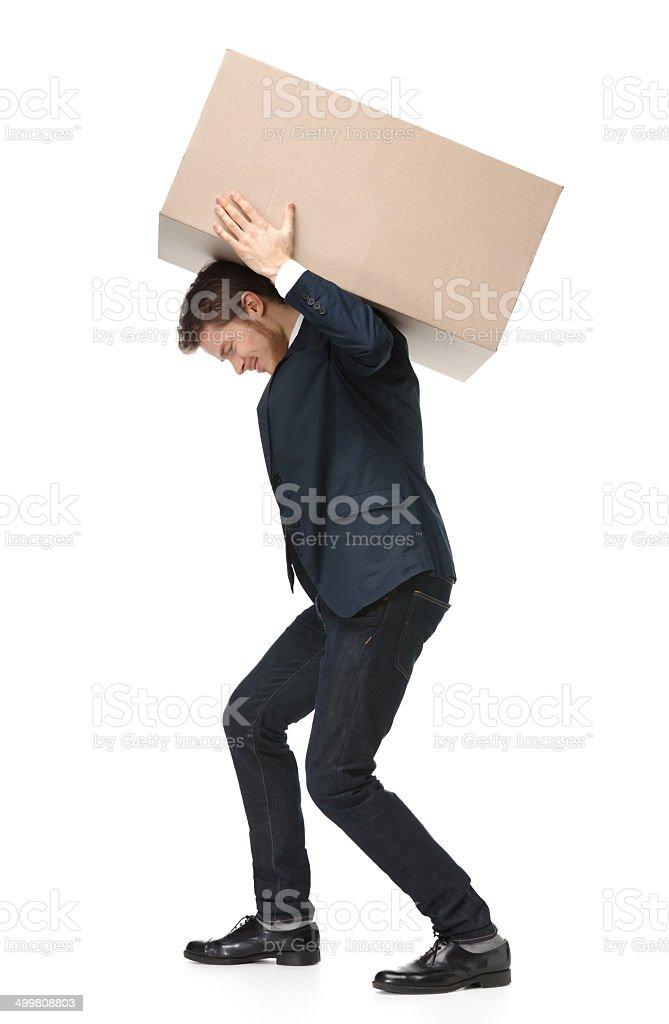 Shop assistant carries the parcel stock photo