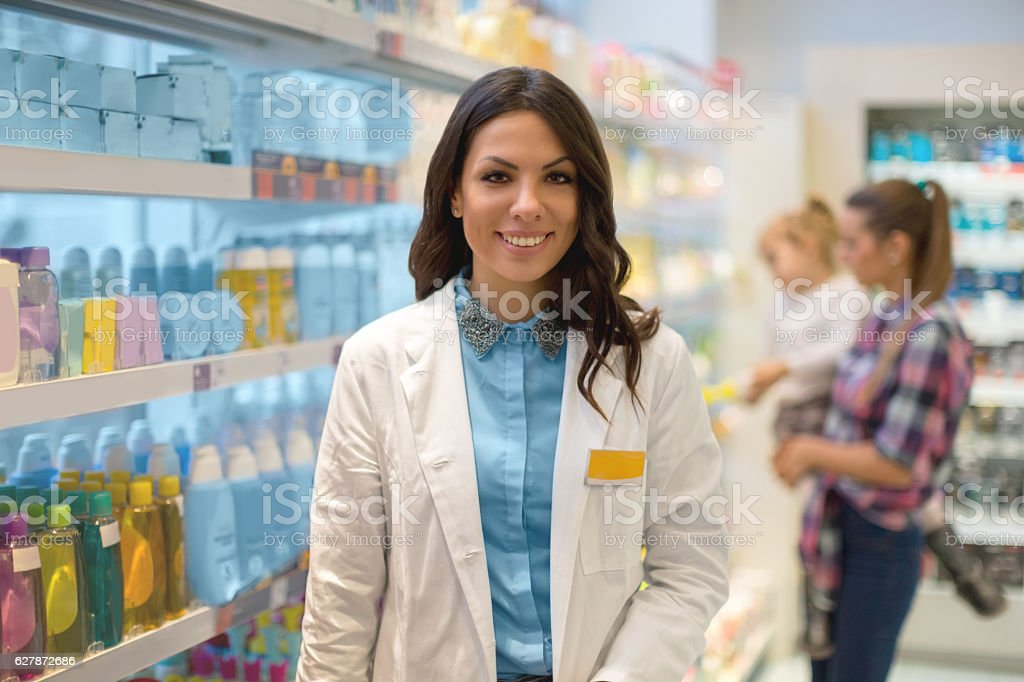 Shop assistant in drug store stock photo