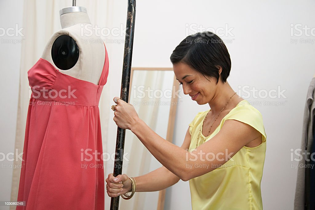 Shop assistant with mannequin stock photo