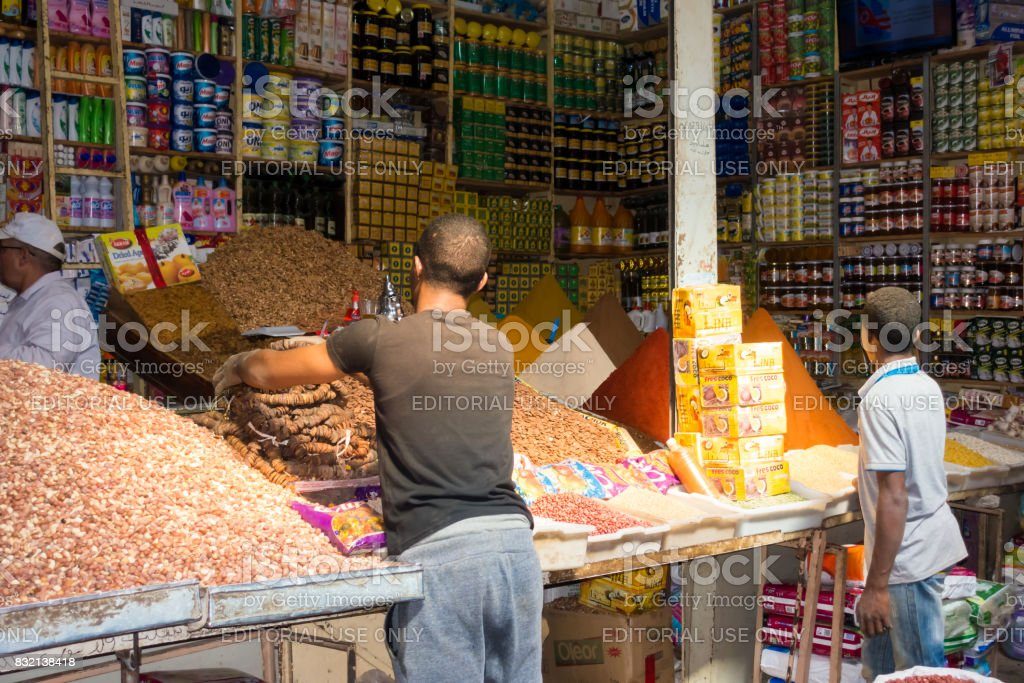 Shop Assistants Filling up Stock at Rissani Market stock photo