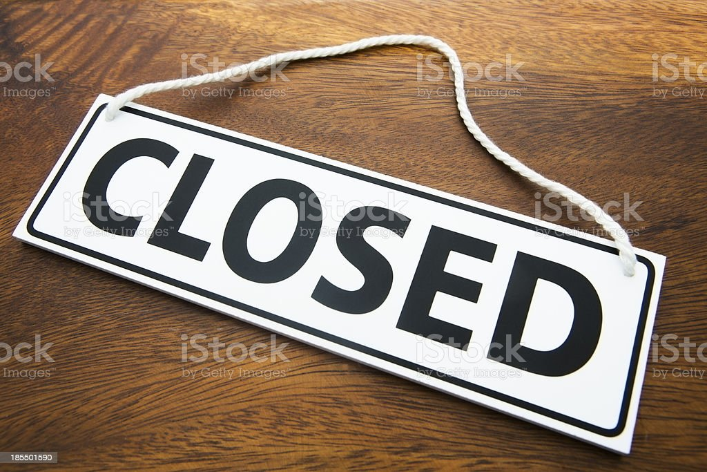 Shop Closed Sign On Wooden Background stock photo