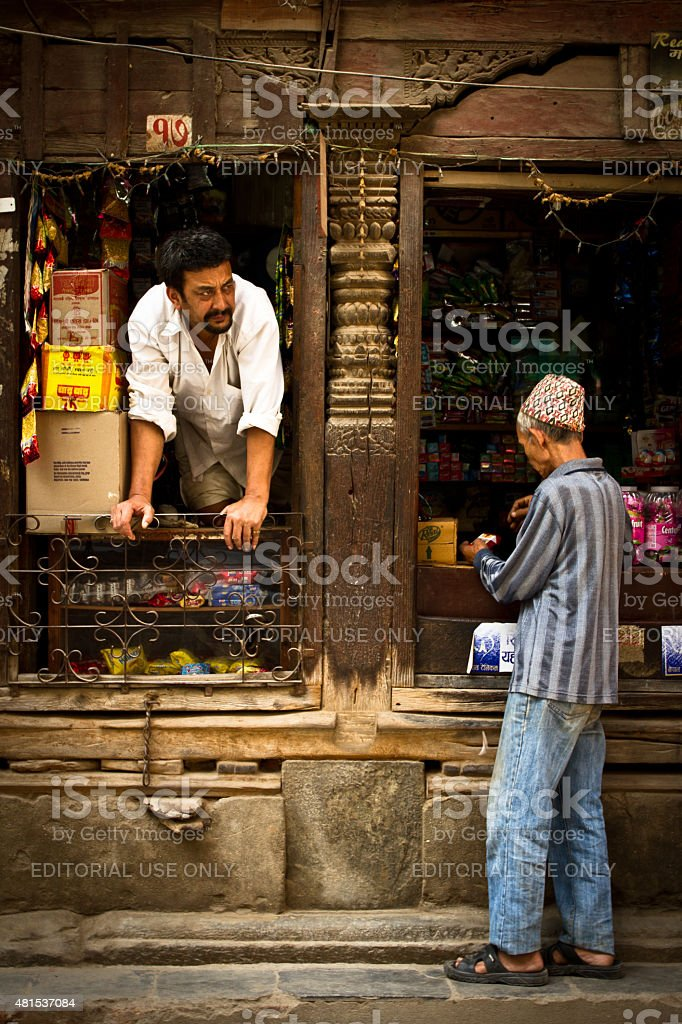 Shop keeper and customer on the streets of Kathmandu, Nepal stock photo