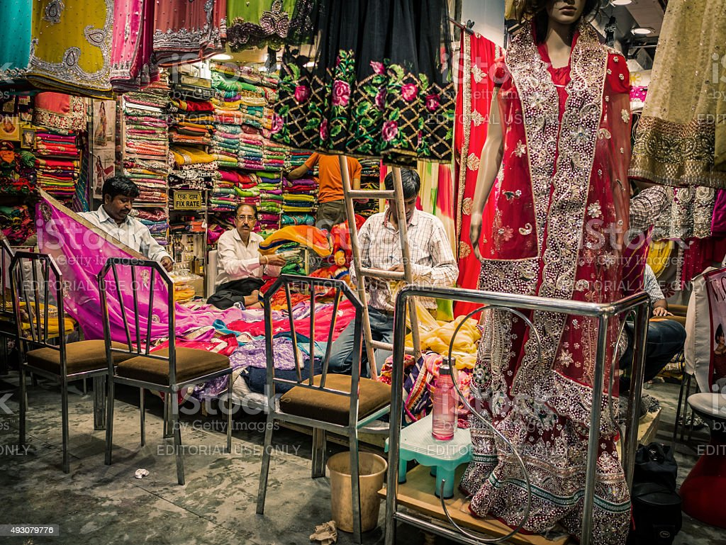 Shop keepers at women garment shop in Jaipur India stock photo