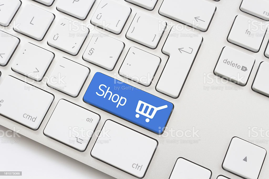 Shop key with shopping cart royalty-free stock photo