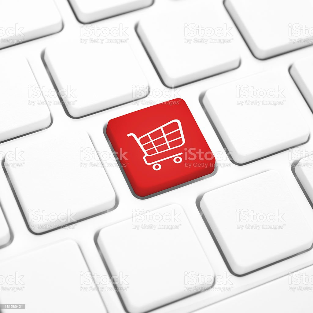 Shop online business concept. Red shopping cart key on keyboard royalty-free stock photo