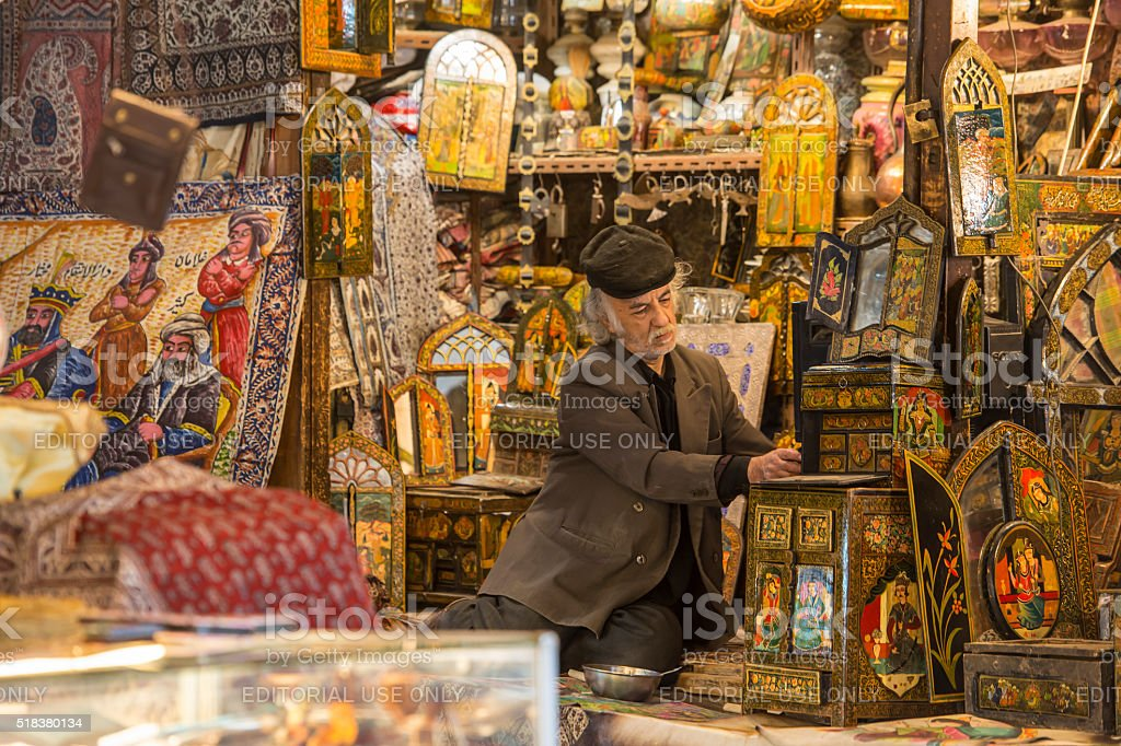 Shop owner in the Imperial Bazaar of Isfahan, Iran stock photo
