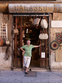 Shop owner stands outside his shop