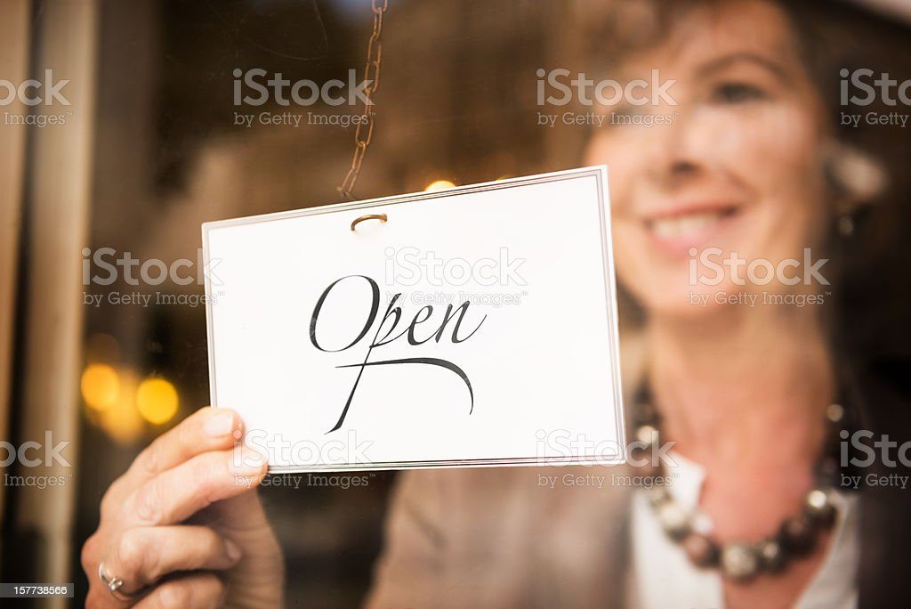 Shop Owner with OPEN Sign stock photo