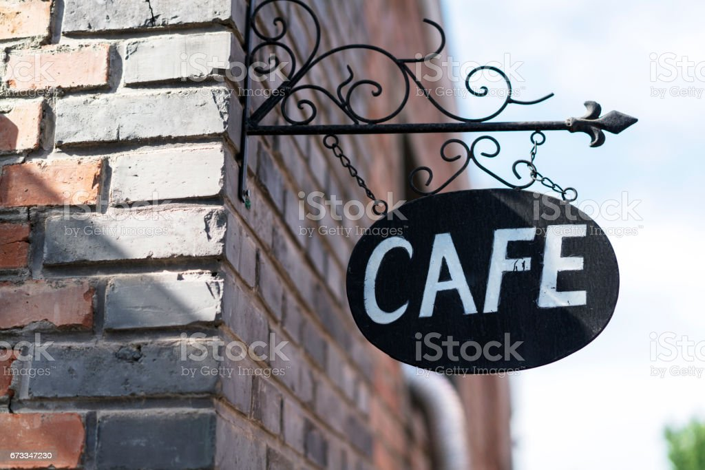 shop sign of cafe on the wall stock photo