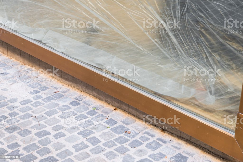 Shop window masked with plastic foil stock photo