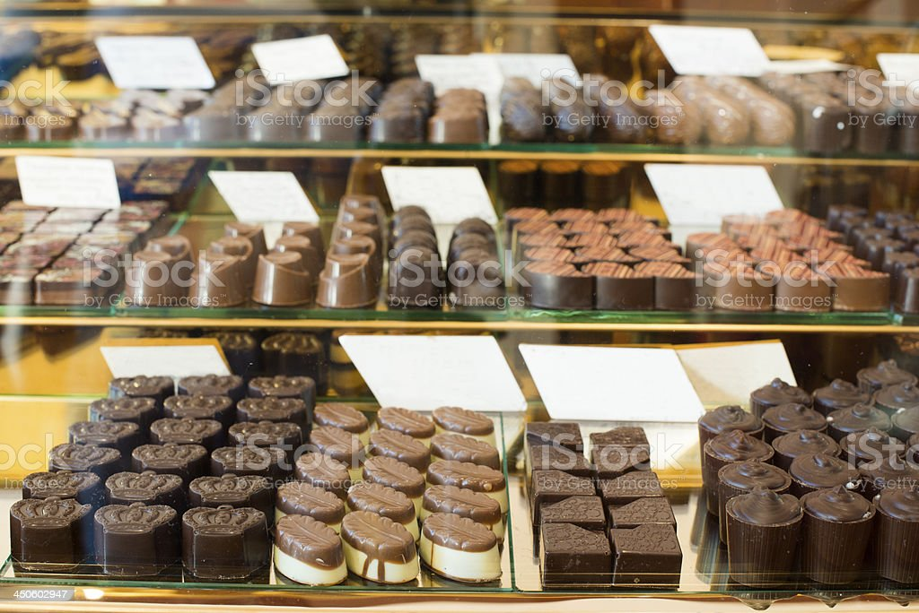 Shop window with selection of specialty chocolates stock photo