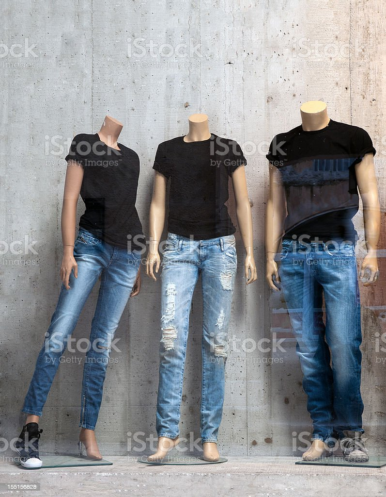 Shop window with three mannequins stock photo