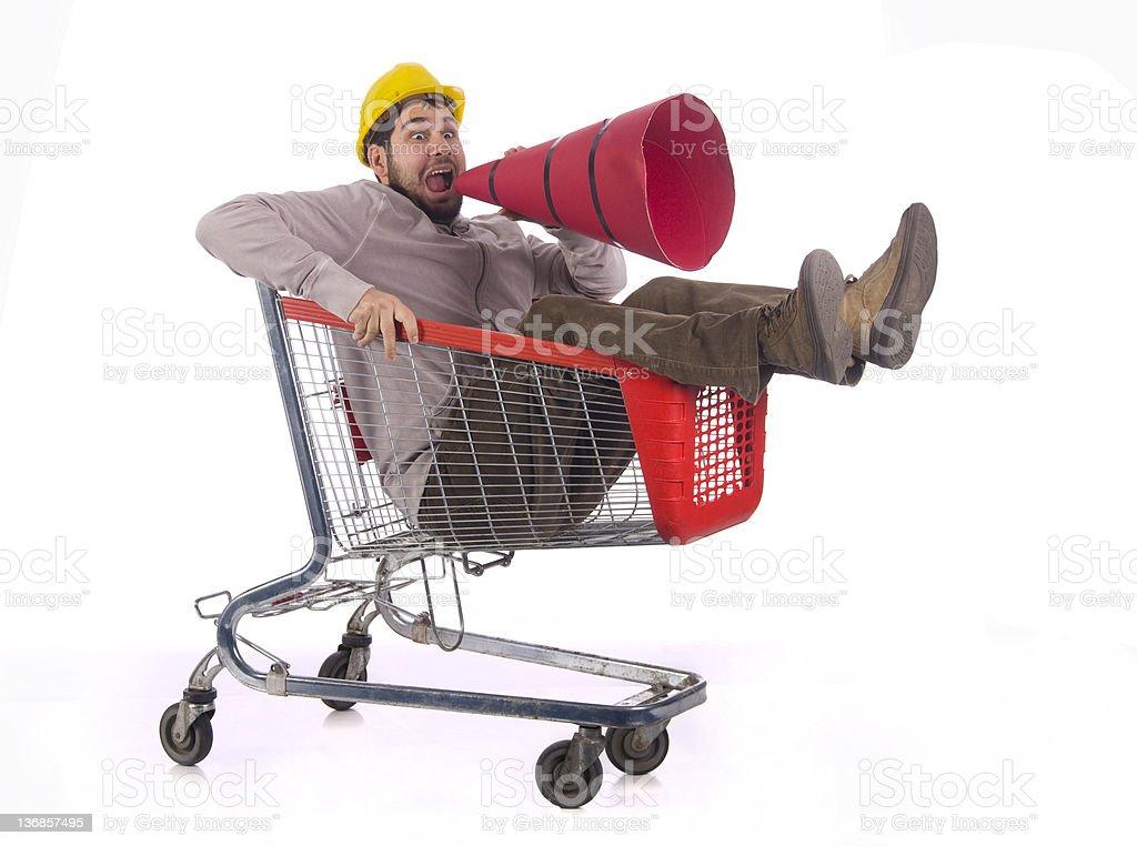 shopaholic in a shopping cart royalty-free stock photo