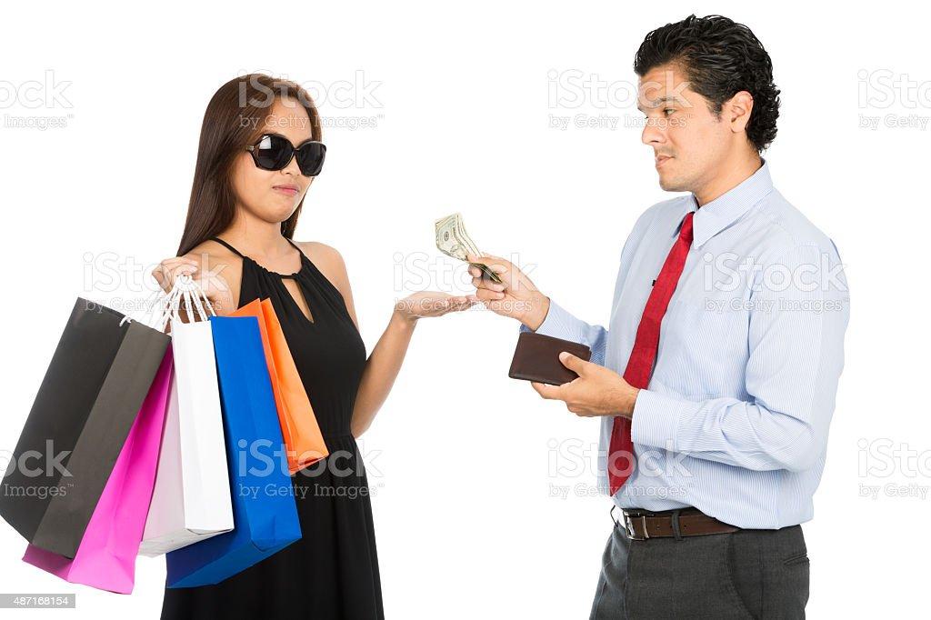 Shopaholic Wife Palm Out Money Reluctant Husband stock photo