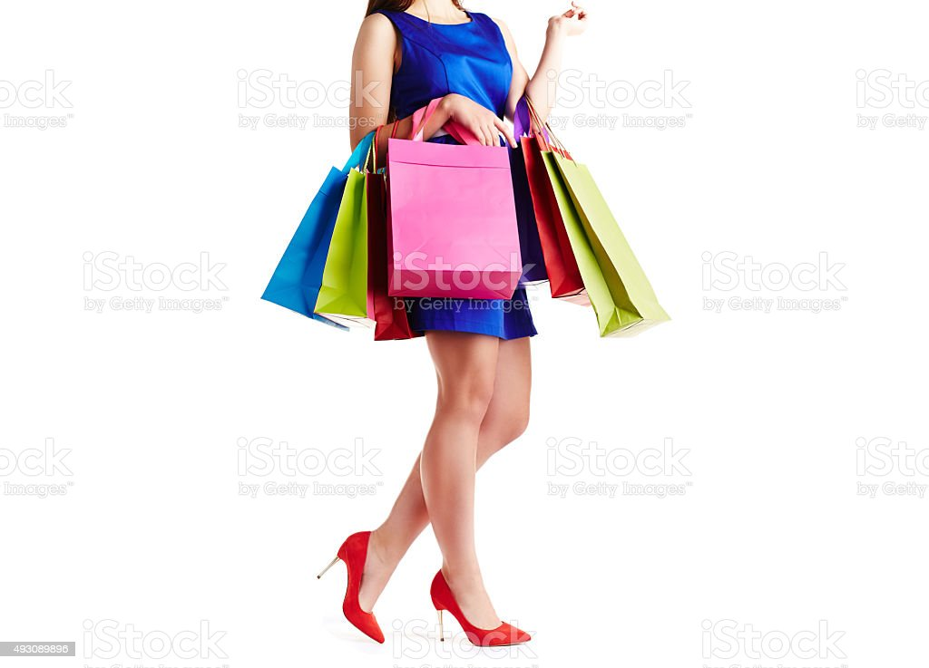 Shopaholic with paperbags stock photo