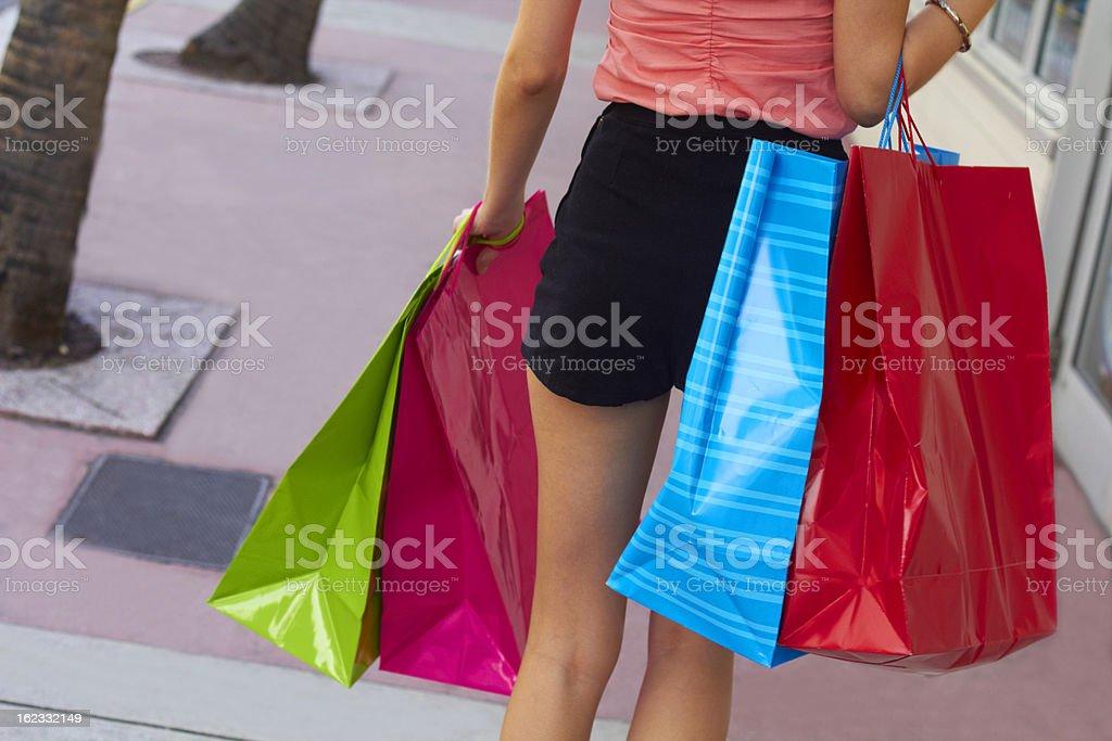 Shopaholic Woman Carrying Bags stock photo