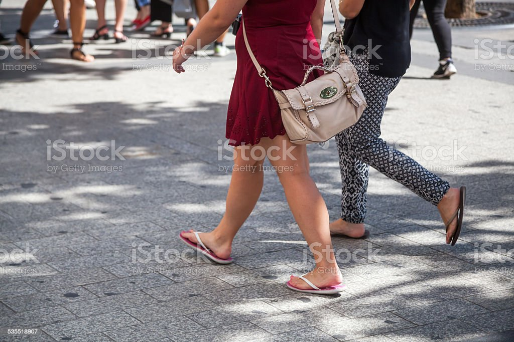 shopinng woman on the move in the city stock photo