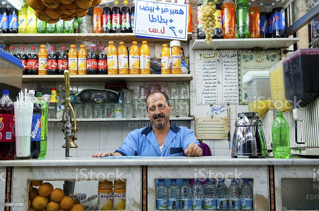 Shopkeeper inside store in Damascus, Syria royalty-free stock photo