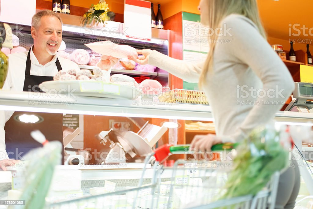 Shopkeeper serving a customer royalty-free stock photo