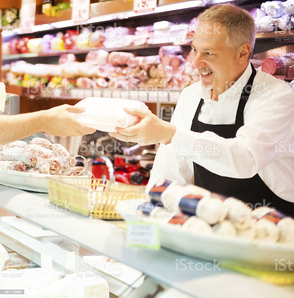 Shopkeeper serving a customer stock photo