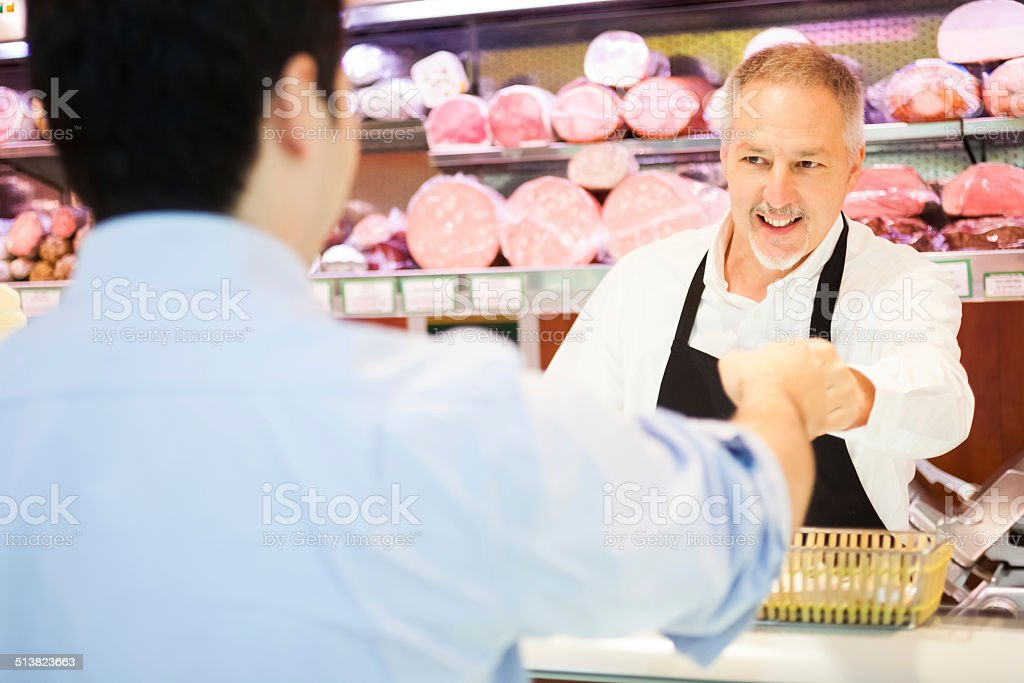Shopkeeper serving a customer stock photo