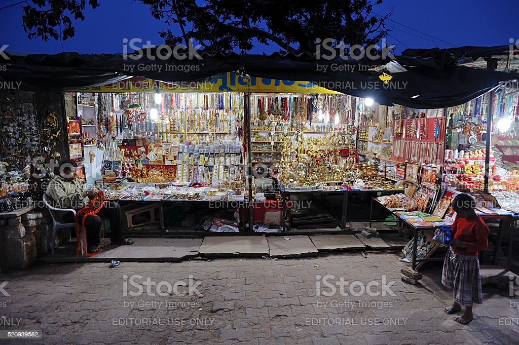 Shopkeeper sit beside his shop at Night market in Orachha stock photo