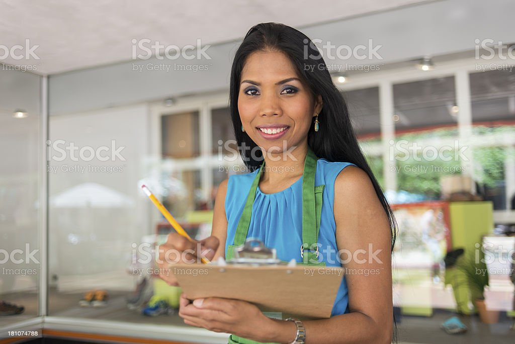 Shopkeeper with Clipboard royalty-free stock photo