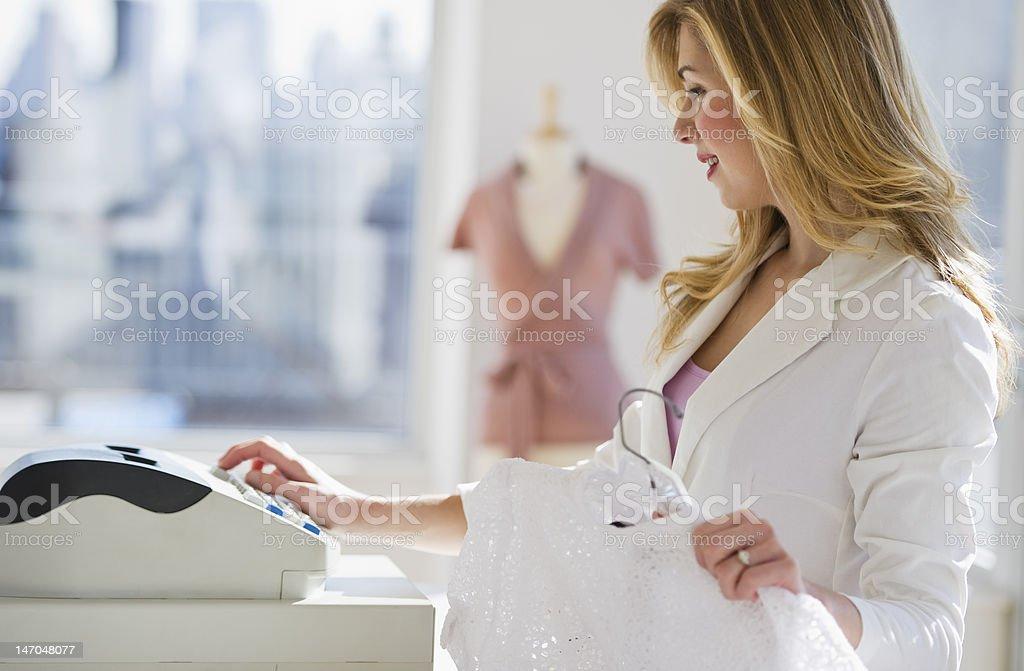 shopkeeper working cash register royalty-free stock photo