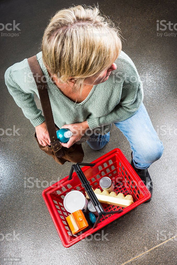 Shoplifter stealing hair product stock photo