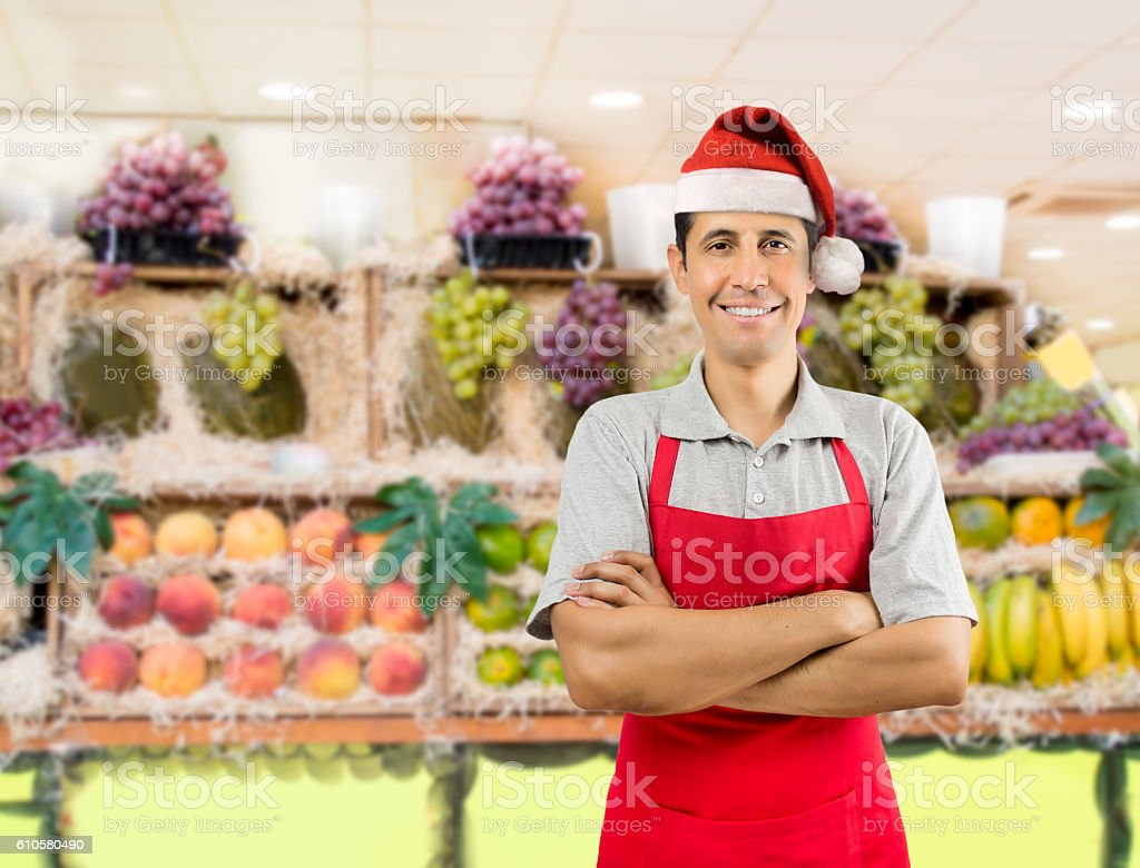 shopman with santa hat stock photo