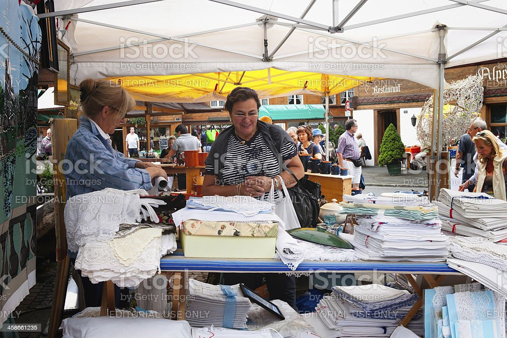 Shopper admiring assortment of linen for sale stock photo