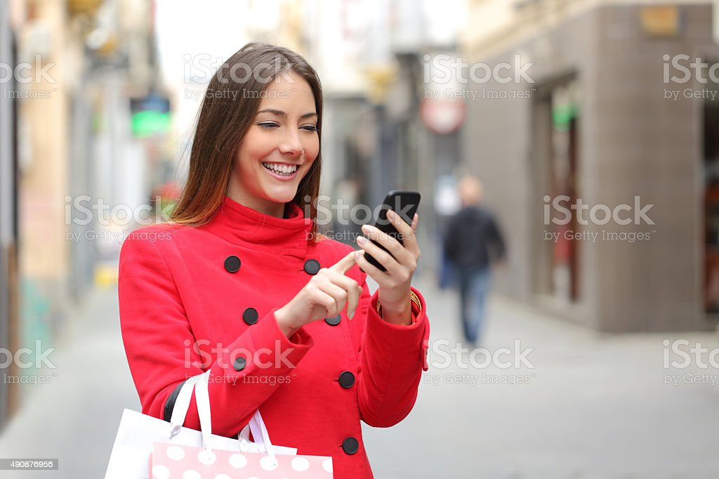 Shopper buying online on the smart phone stock photo