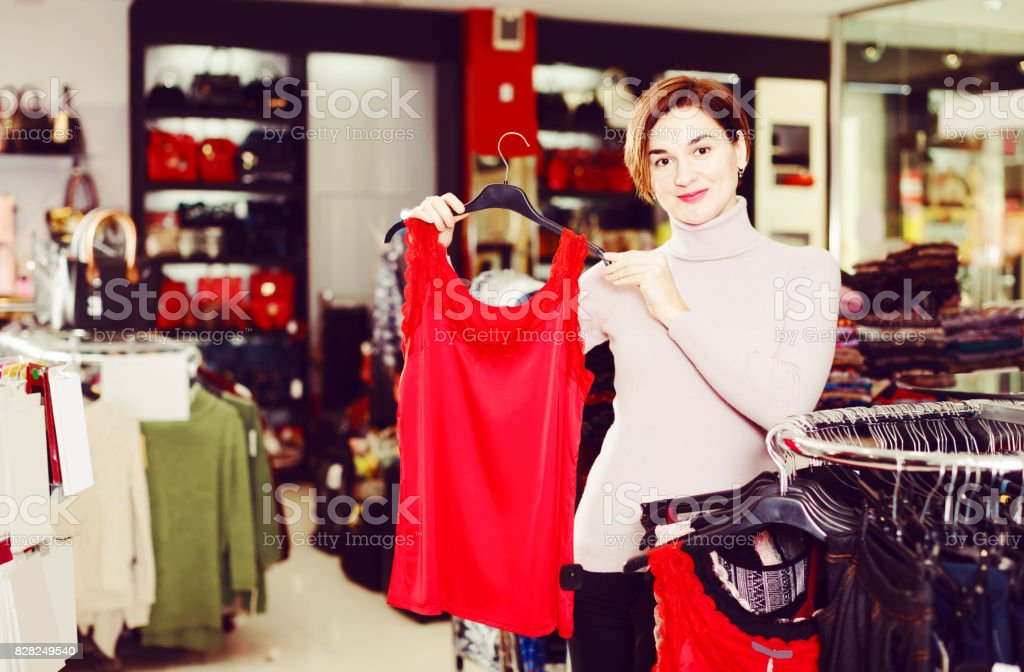Shopper examining blouses stock photo