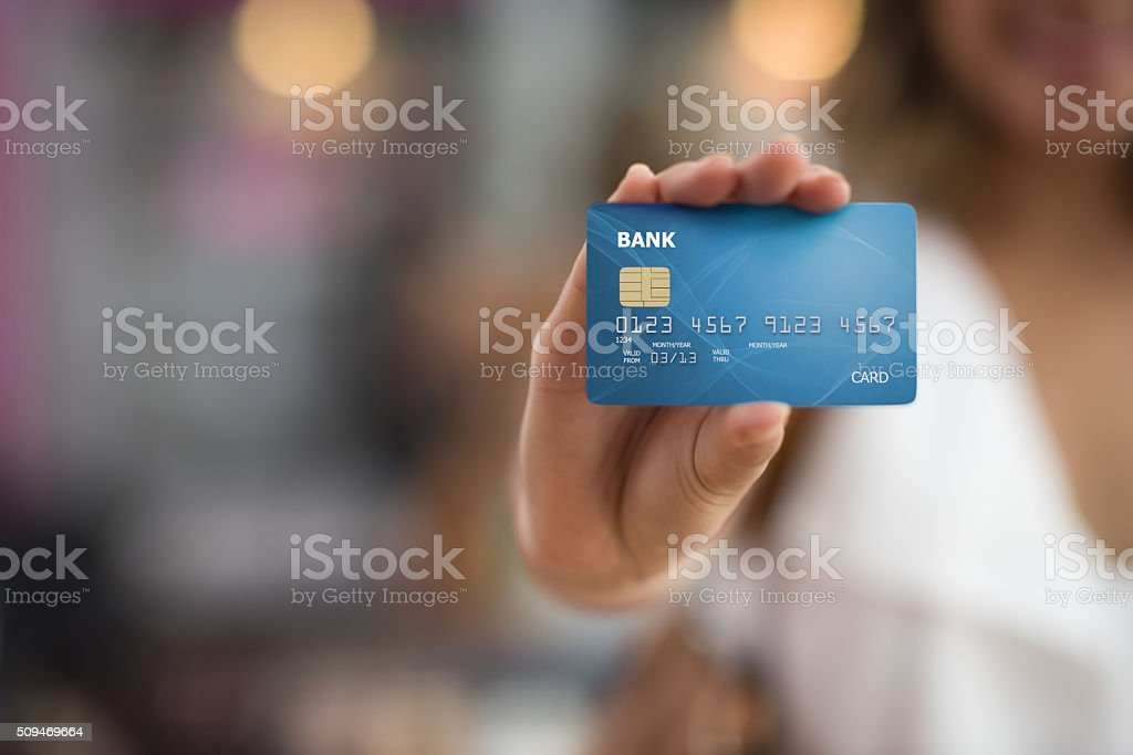 Shopper holding a credit card stock photo