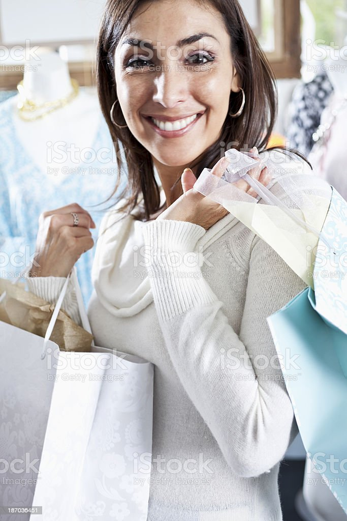 Shopper in boutique with shopping bag stock photo